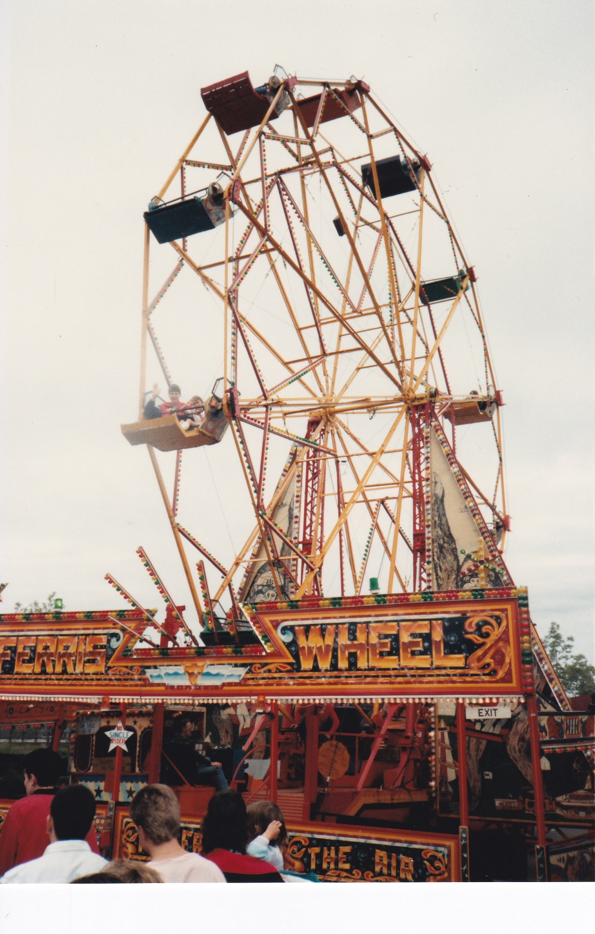Daniel and Debbie on the Ferris Wheel at the St Neots Riverside Park Fair on this day