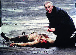Father Alec Reid administers the last rites to Corporal David Howes