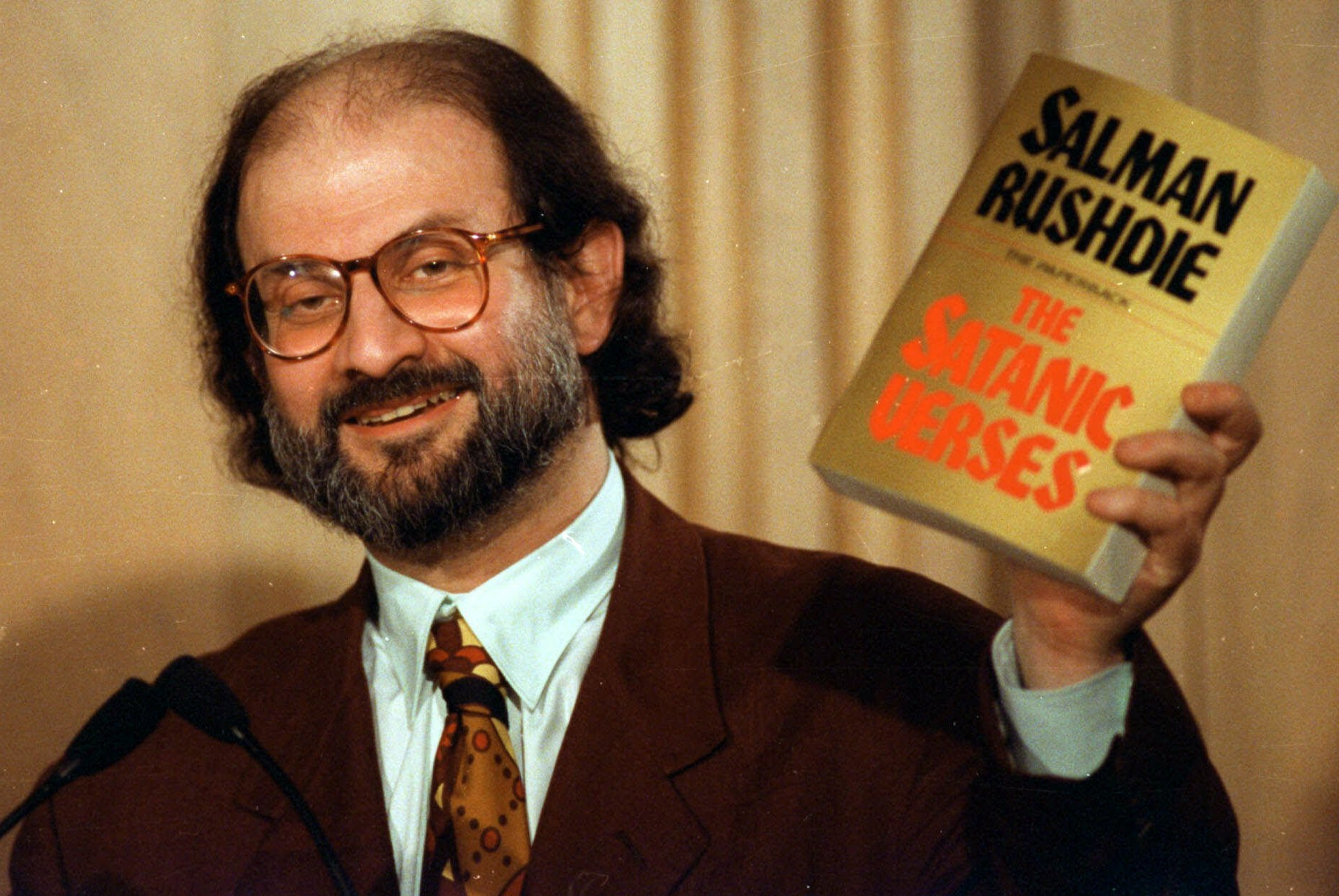 Ayatollah Khomeini incites Islamic fundamentalists to kill Salman Rushdie