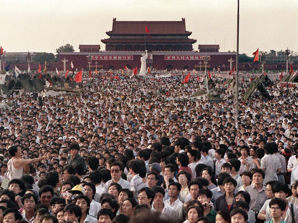 Peaceful Tiananmen Square protests just before Chinese troops killing thousands of peacefully protesting students herew and elsewhere by shooting indiscriminately