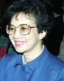 Cory Aquino attends the funeral of three bodyguards, who were shot dead defending her son, who was still shot in the neck.