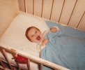 Della laughing in cot June 1985