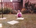 Della squatting in garden 1985