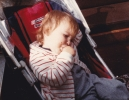 Della tired in push-chair Mundesley, August 1985