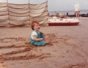 Della playing on the sand Mundesley, August 1985