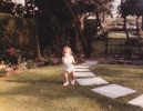 Della running in the Hayling View garden 1985