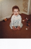 Della squatting on carpet 1985