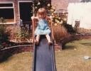 Della on slide 1985