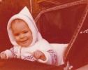 Baby Debbie smiling in her pram 1980