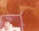Baby Debbie looking down in her pram 1980ish