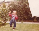 Debbie running on the lawn 1980