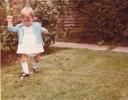 Debbie walking on the lawn 1980
