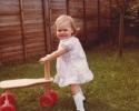 Debbie holding her trike 1980