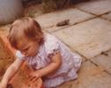 Debbie getting her hands into sandpit 1980