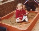 Debbie sitting in the sandpit 1980