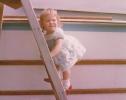 Della climbing the boat ladder, 1980
