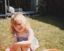 Debbie with her rocking horse in the summer sun 1982