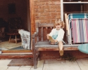 Debbie playing on Grandma Norma's patio 1982