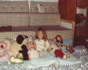 Debbie with her large family of cuddlies 1981