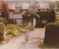 Debbie in front of thatched Huntingdonshire cottage - 1983