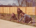 Grandchildren Jane, Stacey and Chris helping tidy the garden after Fred and Grace moved in
