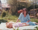 Stacey and sunbathing child