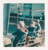 Daniel and friend David Tomblin on the roundabout during a visit to the fair, March 1977