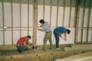 Dave, Allen and Steve working inside of Harnser boathouse lined with fireproof board late 1992