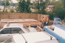 Harnser weatherboard cladding being dried and stained late 1992