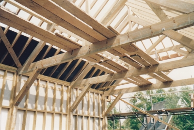 Harnser King post trusses complete, braced and roof felt started late 1992